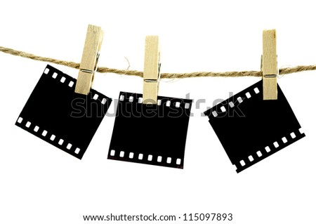 Blank photo frames with hanger on rope with white background - stock photo
