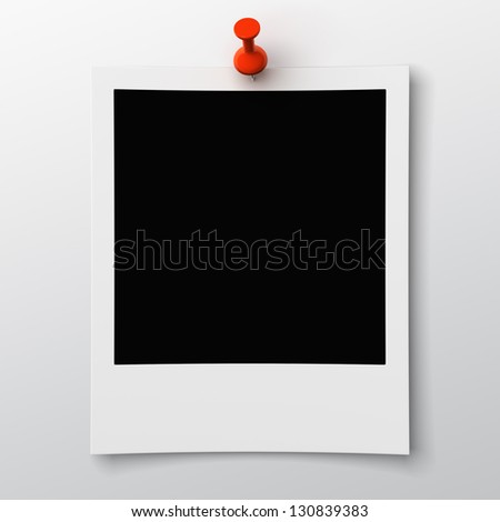 blank photo pinned on wall - stock photo