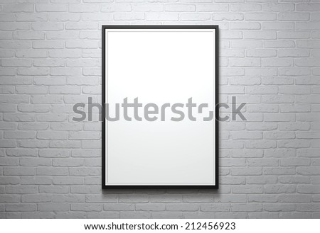 Blank picture frame at the brick wall with copy space and clipping path for the inside - stock photo
