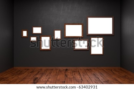 Blank pictures of different sizes in a dark room - stock photo