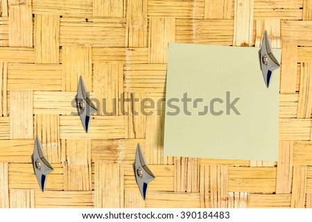 Blank piece of paper attached on an old house bamboo wooden wall with Japanese ninja weapons. Copy space for leaving several messages i.e. notes, reminder, order, information, suggestion, memo, etc - stock photo