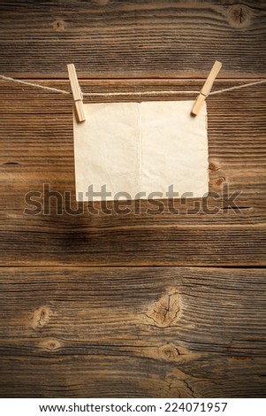 Blank pieces of paper hang on clothesline - stock photo