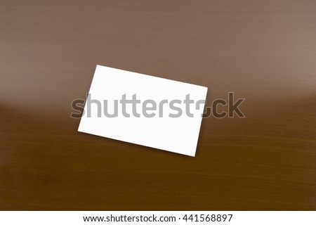 blank placard on a wooden table - stock photo