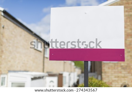 Blank placard sign outside a row of terraced houses - stock photo