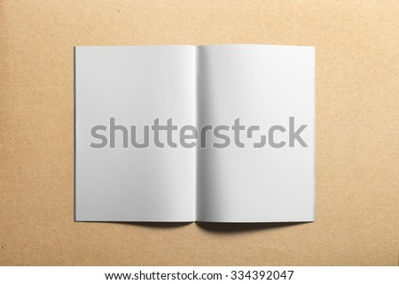 Blank portrait A4, US-Letter, brochure magazine isolated on cardboard background, with clipping path, changeable background - stock photo