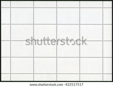Blank postage stamp sheet on black background - stock photo