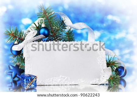 blank postcard, Christmas balls and fir-tree on blue background - stock photo