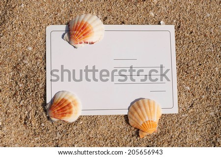 Blank postcard on the sand - stock photo