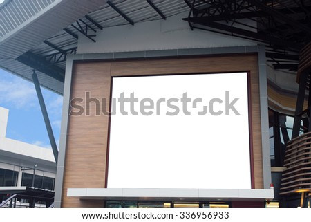 Blank poster billboard wall with copy space for your text message or content in modern shopping mall on a cloudy day. - stock photo