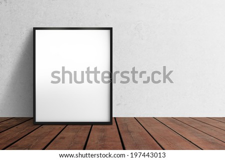 blank poster hanging on wall - stock photo
