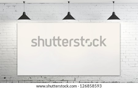 blank poster in room with three ceiling lamp - stock photo