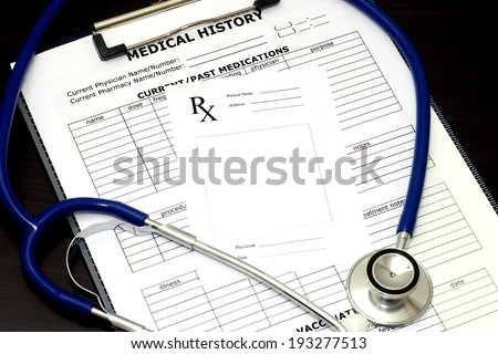 Blank prescription pad with patient medical chart and stethoscope. - stock photo