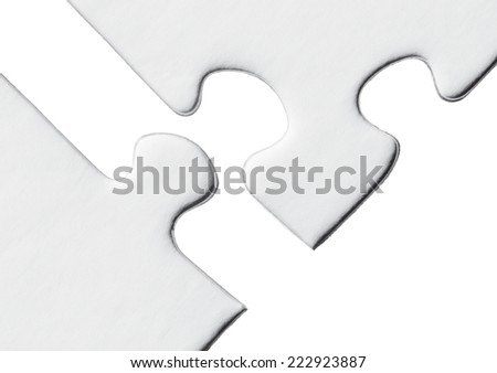 Blank puzzle on a white background - stock photo