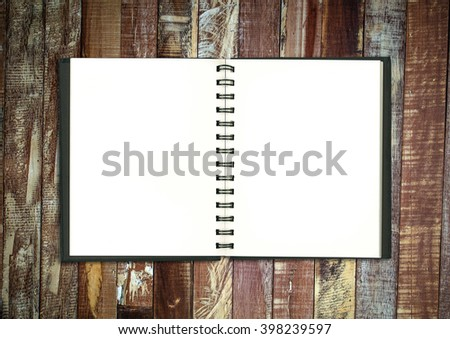 blank realistic spiral notepad notebook on wooden table - stock photo