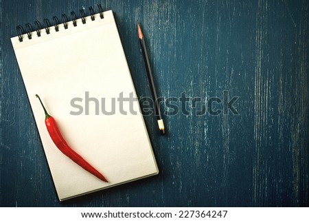Blank recipe book and pencil on old dark blue wooden background - stock photo