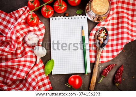 Blank recipe book on a table with vegetables. Food background with copy space, top view - stock photo