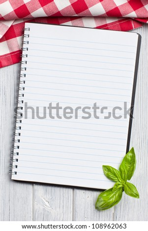 blank recipe book on kitchen table - stock photo
