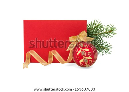 Blank red card with red and gold Christmas ball and gold ribbon on white.  Copy space. - stock photo