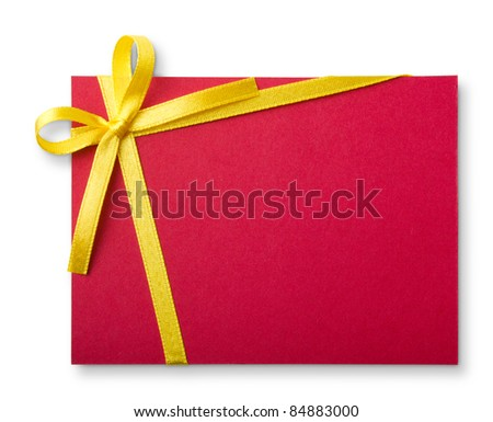 Blank red gift tag tied with a bow of gold satin ribbon. Isolated on white, with soft shadow - stock photo
