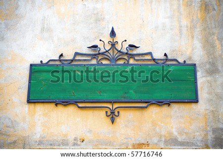 Blank retro or vintage sign on concrete grunge wall - stock photo