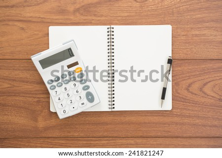 Blank ring binder notebook on wood background - stock photo