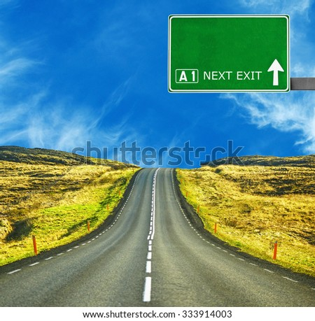 Blank road sign against clear blue sky - stock photo
