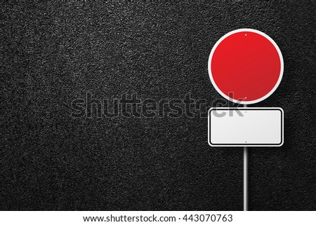 Blank road signs on a background of asphalt. The texture of the tarmac, top view. - stock photo