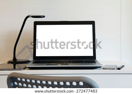 blank  screen laptop computer with table lamp is on twooden desk as workplace concept - stock photo
