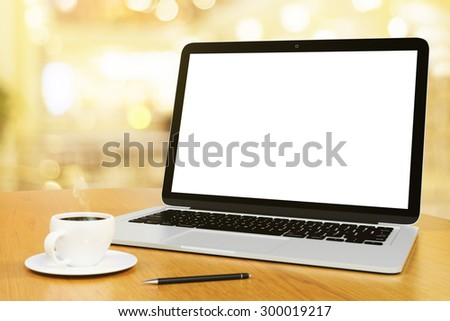 blank screen of laptop with cup of coffee and pen, mock up - stock photo