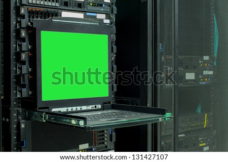 Blank server computer screen in modern interior data Center, server room - stock photo