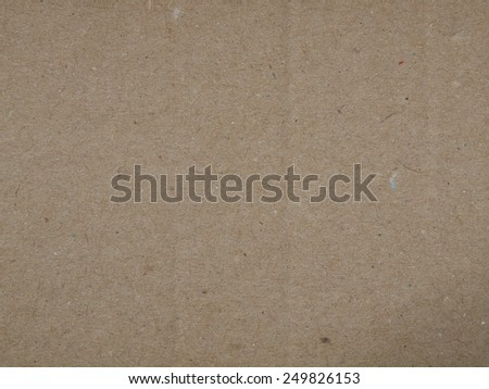 Blank sheet of old brown paper useful as a background - stock photo