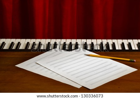 blank sheetmusic with pencil on piano - stock photo