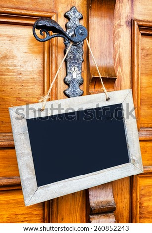 blank sign at a wooden door - stock photo