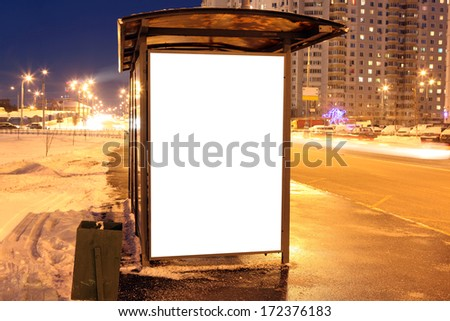 Blank sign at bus stop in city - stock photo