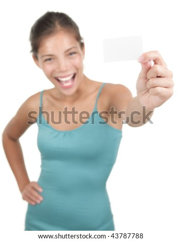 Blank sign / business card. Beautiful young woman with an excited big smile displaying a blank business card / notecard. Shallow DOF, focus on card. Isolated on white. Mixed asian / caucasian model. - stock photo