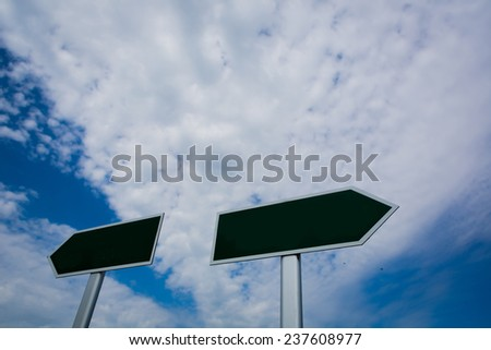 Blank signpost over blue sky - just add your text. - stock photo