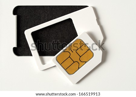 Blank SIM card isolated on black background. - stock photo