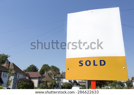 Blank SOLD sign outside a building, space for text to be added - stock photo