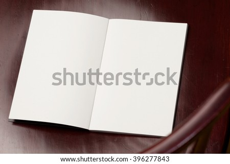 Blank spread, open book on old wooden table. - stock photo