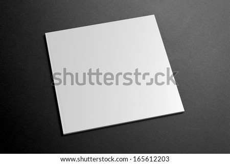 Blank square Magazine on the dark Background for your design - stock photo