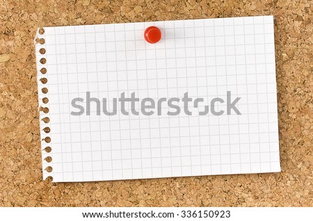 Blank squared note page fixed on cork board with thumb tack - stock photo