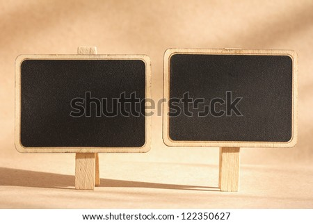 blank standing blackboard on brown background - stock photo