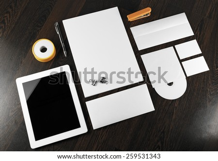 Blank stationery and corporate identity template on dark wooden background.  For design presentations and portfolios. - stock photo