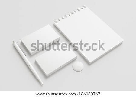 Blank Stationery / Corporate ID Set isolated on white. Consist of Business cards, pens, button and memobook - stock photo