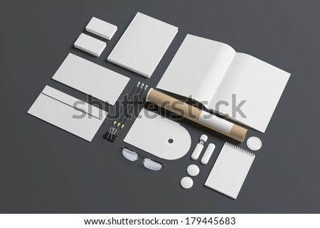 Blank stationery set isolated on grey. Consist of book, magazine, business cards, pencils, envelopes, tubus, cd disk. - stock photo