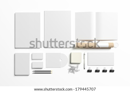 Blank stationery set isolated on white. Consist of folder, book, note, magazine, business cards, penl, cd disk, buttons, envelopes, tubus. - stock photo