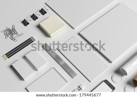 Blank stationery set isolated on white. Consist of folder, note, business cards, pencils, tubus, letterheads - stock photo
