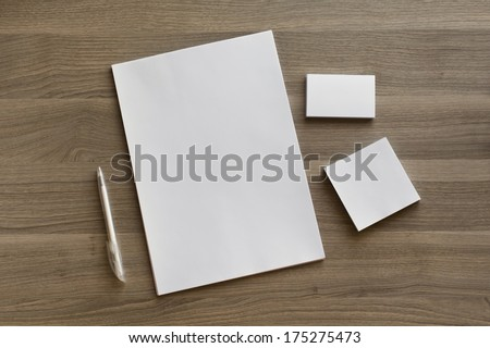 Blank stationery set on wood background / a4 paper, business cards, sheets and pen - stock photo