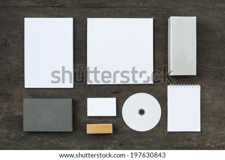 Blank stationery set on wood background: business cards, booklet