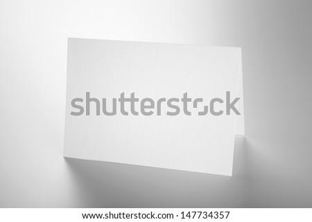 Blank stationery: standing card over grey background with shadow - stock photo